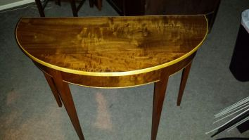 Demi Lune handcrafted hardwood table by Ron Jackson